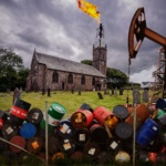Image of a church with oil barrels and flare