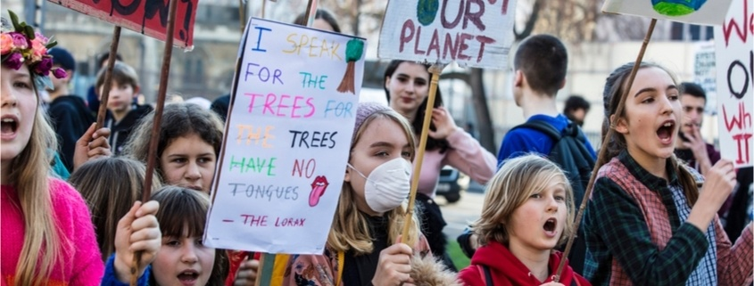 Protestors with banners at a Youth strike for climate march in central London