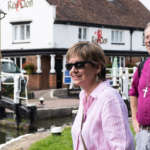 Bishop Steven and fellow pilgrims stand in front of a lock along a Milton Keynes canal