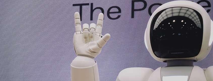 A robot raises a hand